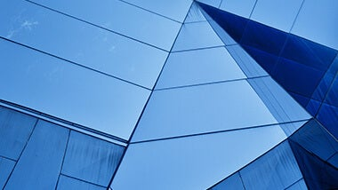 Blue glass building with lines